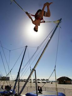 "Tyler Bernstein, 13, of St. Louis, celebrates the first day of         winter by performing aerial somersaults on the beach at Marco         Island, Fla., Dec. 22, 2011. Said Bernstein: ""My sister's been         on the gymnastics team for six years. It looked like fun. I was         trying for three somersaults in a row, because that's what she         can do, but I only got two. I was a little dizzy 15 feet in the         air but it was cool because you could see the ocean when you         were flipping. It was a little scary. I was trying to make sure         I didn't land on my head. But it wasn't that scary after the         first one. The judges gave me a 2 so I think I'll go back to         hockey and lacrosse."""