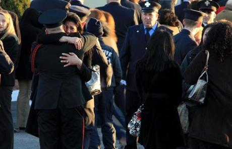 Peabody, MA 122911 An unidentifed firefighter consoles a woman outside of the wake of fallen Peabody firefighter James M. Rice at the Conway Cahill- Brodeur Funeral Home in Peabody on December 29, 2011. (Essdras M Suarez/ Globe Staff)/ MET