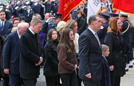 BOSTON, MA 12/ 30/ 2011: Family members walk behind the casket entering the church for Peabody Firefighters funeral James Michael Rice in Peabody at St John the Baptist Church. ( David L Ryan / Globe Staff Photo ) SECTION: METRO TOPIC : 31peabody REPORTER