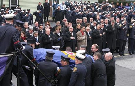 BOSTON, MA 12/ 30/ 2011: The casket of Peabody firefighter James Michael Rice is taken from his Engine in Peabody at St John the Baptist Church. ( David L Ryan / Globe Staff Photo ) SECTION: METRO TOPIC : 31peabody REPORTER