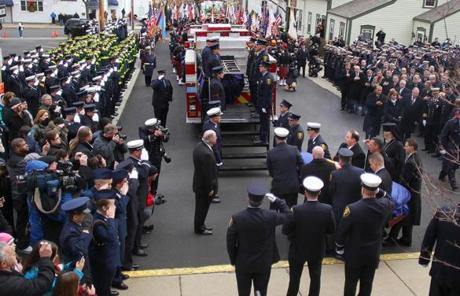 Peabody, Mass. -12/30/11 - Funeral services were held for Peabody firefighter James M. Rice at St. John The Baptist Church, as hundreds of firefighters from all over came to pay respect. Pallbeares carry his casket to his firetruck at the end of the service, as a large vrowd is present in front of the church. Globe staff photo by John Tlumacki (metro)