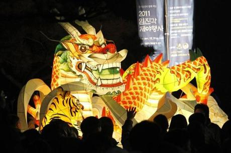 a giant dragon lantern is displayed to celebrate the new year near the border village of