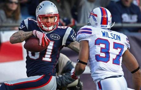 Aaron Hernandez struck  a pose just for the Bills' George Wilson as he strode untouched into the end zone in the second quarter.