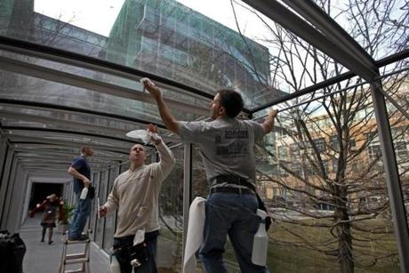 BOSTON, MA 01 / 06 / 2012: Washing windows in the glass tunnel L-R in blue top Mark McCusker (cq) , Scott Fulton (cq) and Phil DiChiara (cq) at The Isabella Stewart Gardner museum getting ready, the big run up to the opening of the Gardner's new building . ( David L Ryan / Globe Staff Photo ) SECTION: LIFESTYLE TOPIC : REPORTER Geof Edgers