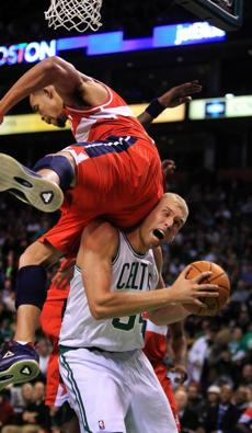 Boston, Ma-January 2,2011--Globe staff photo by Stan         Grossfeld----For What They Were Thinking---- Celtics rookie         center Greg Stiemsma (cq), making his first NBA start, gets         fouled by Washington's JaVale (cq) McGee in the third quarter of         a Celtics 100-92 victory over the Washington Wizards at TD         Garden.