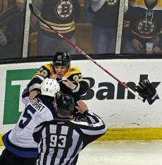 The gloves (and sticks) came off as the Bruins' Shawn Thornton and the Jets' Mark Stuart engaged in a second period fight. Jan. 10, 2012.