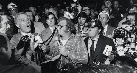 5/7/1976 Mayor Kevin White shouts over union members gathered in the lobby of City Hall as he tells them of the results of his meeting with the business agents and what he would do about third world construction demands.