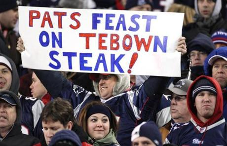 slider -- AFC PLAYOFF Patriots/Jets 01/14/2012 A Patriots fan holds a sign making fun of Broncos QB Tim Tebow's last name. slider The New England Patriots play the Denver Broncos in the 2012 AFC Divisional Playoff Game at Gillette Stadium, in Foxborough, MA, Sunday, January 16, 2011. (Jim Davis/Globe Staff Photo)