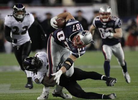 FOXBOROUGH, MA JANUARY 22, 2012 AFC CHAMPIONSHIP NEW ENGLAND PATRIOTS VS. BALTIMORE RAVENS New England Patriots' Rob Gronkowski #87 runs the ball in the third quarter of the game against Baltimore Ravens on Sunday, January 22, 2012 at Gillette Stadium in Foxborough, MA. This is the play that he gets injured on.(Barry Chin/Globe Staff Photo)