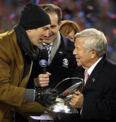 Foxborough, MA - 01/22/12 - Former New England Patriots quarterback and an honorary captain today Drew Bledsoe with Patriots owner Robert Kraft with the AFC Lamar Hunt Championship Trophy. The New England Patriots took on the Baltimore Ravens in the AFC Championship game at Gillette Stadium in Foxborough. - (Globe Staff Photo / Barry Chin), section: Sports, reporter: Young (Shalise), slug: 23Patriots-Ravens, LOID: 5.0.781019577.