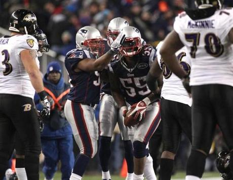 FOXBOROUGH, MA JANUARY 22, 2012 AFC CHAMPIONSHIP NEW ENGLAND PATRIOTS VS. BALTIMORE RAVENS New England Patriots' celebrate Brandon Spikes #55 interception in the fourth quarter of the game against Baltimore Ravens on Sunday, January 22, 2012 at Gillette Stadium in Foxborough, MA. (Jim Davis/Globe Staff Photo)