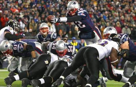 slider -- FOXBOROUGH, MA JANUARY 22, 2012 AFC CHAMPIONSHIP NEW ENGLAND PATRIOTS VS. BALTIMORE RAVENS New England Patriots' Tom Brady #12 scores a touchdown in the fourth quarter of the game New England Patriots against Baltimore Ravens on Sunday, January 22, 2012 at Gillette Stadium in Foxborough, MA. (Stan Grossfeld/Globe Staff Photo)