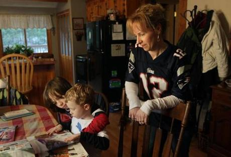 Troy, NH - 1-24-12 - Jodi Lloyd (cq) at her home with her sons l-r Cullen (cq) and Carson (cq). Her husband Steven's hands have been used in a double-handed transplant last fall at Brigham and Woman's Hospital. (Globe staff photo / Bill Greene) section:H&S, topic: 02hand