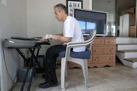 Revere, MA., 01/26/12, Richard Mangino, cq, lost his arms and legs ten years ago. Four months ago he got a double hand-transplant. We visit him at his home to see his progress. He can play the piano again. Section: Health Science, Reporter: Liz Kowalski Suzanne Kreiter/Globe staff