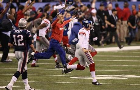 The New York Giants ran onto the field after Tom Brady's hail mary pass fell incomplete at the end of the game.