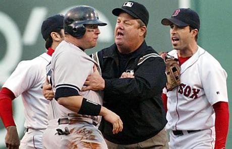 Umpire Joe West cooled down Yankees outfielder Karim Garcia after a force out at second base, an altercation that would set the stage for later fireworks.