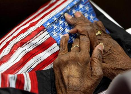 The hands of 86-year-old Doris Neal from Dorchester rest on her pocketbook as she listens to speeches during Adult Health Advocacy Day in the Gardner Auditorium at the State House. People gathered to bring attention to budget cuts made to programs affecting 11,000 elders and disabled adults. (March 22, 2011)
