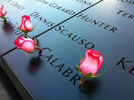 Roses left on a couple of the names at the 9/11 Memorial.