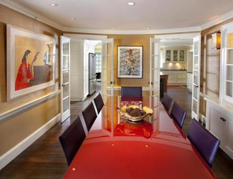 In The Dining Room, A Gold Toned Grass Cloth Wallcovering, Red Lacquer Table