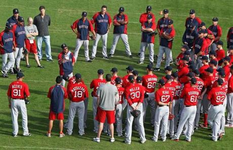 Red Sox manager Bobby Valentine, center, is running his first camp as the team's new field general in Fort Myers, Fla.
