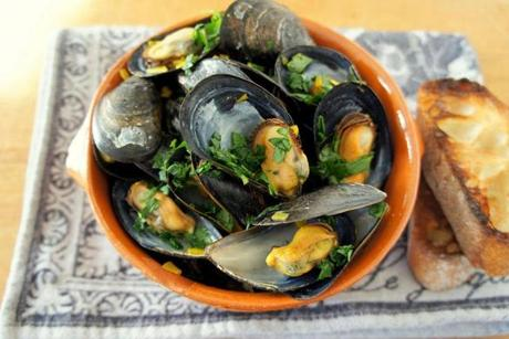 Mussels in white wine with saffron. Blue mussels are on the New England Aquarium's approved fish list.
