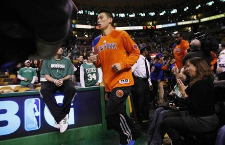 Knicks guard Jeremy Lin ran onto the court before the Knicks faced the Celtics at TD Garden Sunday.