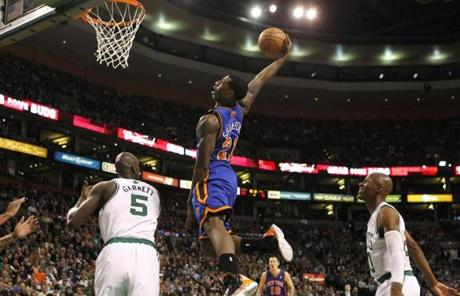 Knicks rookie guard Iman Shumpert went up for a shot between Kevin Garnett and Ray Allen in the second half.