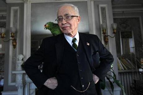 John Lorimer Worden III at his home in Arlington with his parrot Tosca.