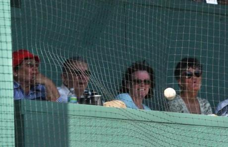 There are seats in the wall that are protected by netting. Balls that hit the netting are live.