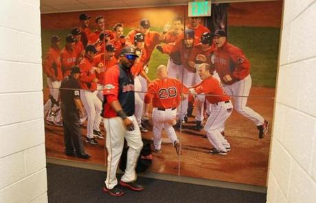 David Ortiz walked back to the clubhouse past a mural of a Red Sox walk-off victory.
