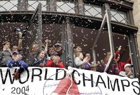Hundreds of thousands of fans turned out in the streets of Boston to fete the 2004 world champion Red Sox.