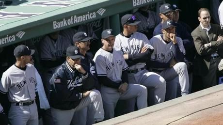 The archrival Yankees watched the ceremonies from the visiting dugout.