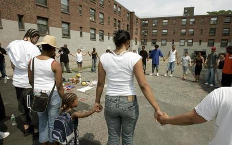 South Boston,MA 07/27/07 Friends and neighbors gather around memorial for Alberto Duarte,24, gunned down last night on in a courtyard on East Ninth Street in the Old Colony Housing project. (George Rizer/globe staff)