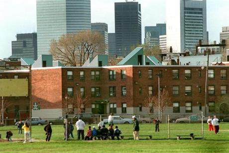 South Boston 4/25/97-A baseball game takes place in front of the Old Colony Projects off Columbia Road. The Boston skyline rises in the distance.