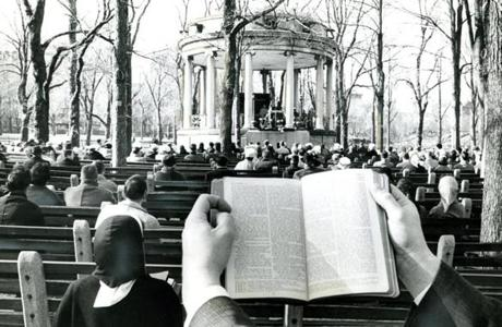 April 2, 1961: Worshipers during sunrise services on the Boston Common wore coats as protection against the wind and cold. The day was hardly conducive to light Easter finery. A few hours later, the Common grass was covered with snow and the wind howled to a gale.