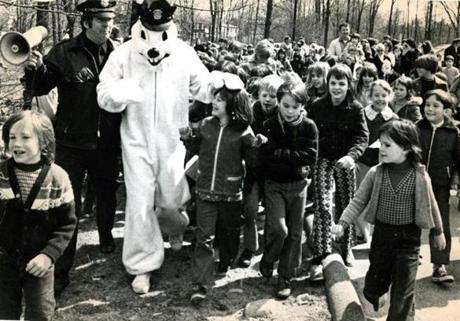 April 7, 1974: Patrolman Bunny, better known as Patrolman Dennis Pearse of the Avon Police Dept., was accompanied by Sargeant Robert Geary as he arrived for the Easter egg hunt attended by more than 300 children.