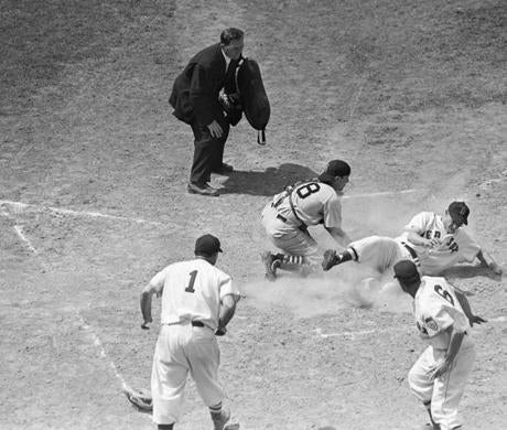Dom DiMaggio slid home with an inside-the-park home run against the White Sox on June 24, 1951.