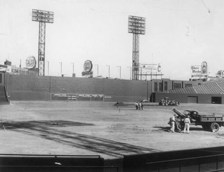 Grounds crew workers laid down new turf in 1957.