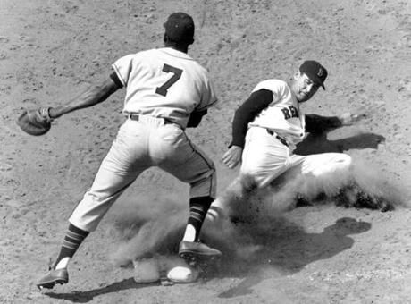 Ted Williams slid safely into second base in this game against Kansas City on July 25, 1957.