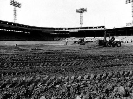 The Fenway Park grounds grew was at work laying new sod down in March 1968.