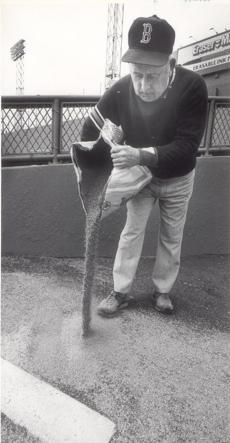 Groundskeeper Jim McCarthy did some maintenance on the bullpen mound in 1983.