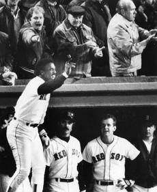 Jim Rice saluted the fans after his three-run home run against the Angels in Game 7 of the 1986 ALCS.