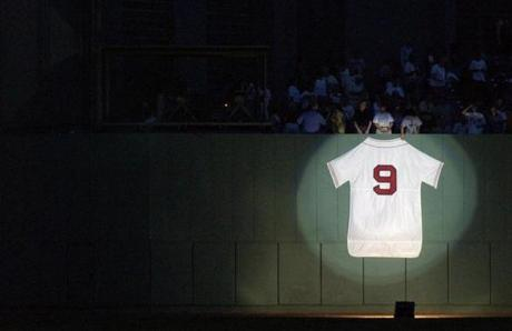 A light shone on Ted Williams' jersey hung on the center field wall during the Red Sox' tribute to him on July 22, 2002.