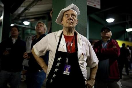 Rae Lunam, a vendor at Stand 7, took a break to watch part of Yankees-Red Sox game on Sept. 16, 2007.
