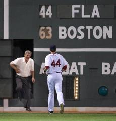 Bruins legend Bobby Orr emerged from the wall to greet left fielder Jason Bay on June 17, 2009.