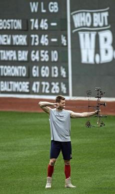 Jonathan Papelbon used the break between games of a doubleheader with the Rays on Aug. 16, 2011, to take some target practice in the outfield.