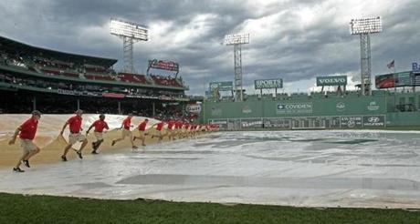 The grounds crew was busy removing the tarp after a rain delay on Aug. 2, 2011.