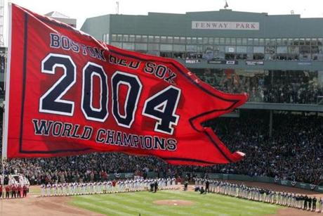 The Red Sox raised the championship banner high on the center field flagpole.