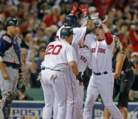 J.D. Drew, right, celebrated after belting a grand slam against the Indians in Game 6 of the 2007 ALCS.