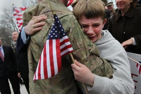Braintree, MA - 3-26-12 - Robert McCarthy (cq) of Braintree greets his 10 year old son Liam (cq) at the Braintree Armory. Homecoming for